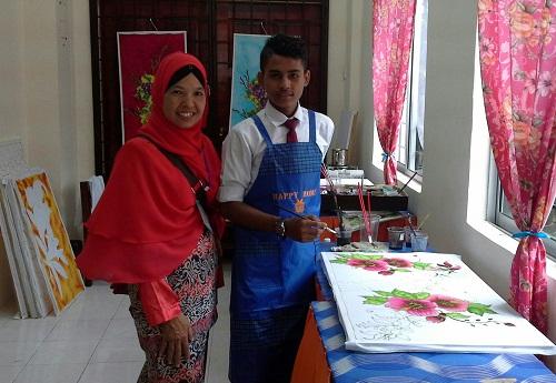 Dokumentasi Foto penulis bersama salah seorang siswa PKKI di Kelas PPKI SMK Seremban 2